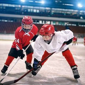 76348622-young-children-play-ice-hockey